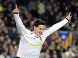 Valencia's Pablo Piatti celebrates a goal against Barcelona on February 12, 2013