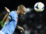 SSC Napoli's captain Paolo Cannavaro heads the ball during the friendly match SSC Napoli vs Galatasaray at San Paolo Stadium in Naples on July 29, 2013