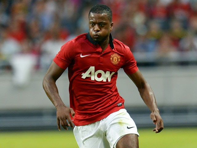 Manchester United's defender Patrice Evra controls the ball during a friendly football match between AIK and Manchester United on August 6, 2013