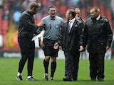 Doncaster boss Paul Dickov complains to the officials after the game with Charlton is stopped due to a waterlogged pitch on August 24, 2013