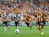Hull's Robbie Brady scores the opening goal from the penalty spot against Norwich on August 24, 2013