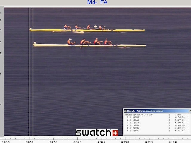 Matthew Pinsent, Ed Coode, James Cracknell and Steve Williams of Great Britain cross the line to claim gold from the Canada team of Barney Williams, Jake Wetzel, Thomas Herschmiller and Cameron Baerg in the men's four rowing final on August 21, 2004 durin