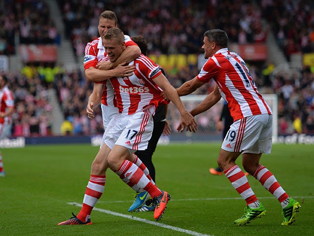 Stoke's Ryan Shawcross is congratulated by team mates after scoring his team's second goal against Crystal Palace on August 24, 2013