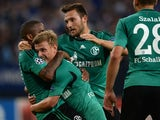 Schalke's teammates celebrate scoring during the UEFA Champions League play-off first leg football match Schalke 04 vs Greece's PAOK Salonika in Gelsenkirchen, western Germany on August 21, 2013