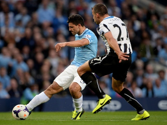 Man City striker Sergio Aguero shoots to score the second goal against Newcastle on August 19, 2013