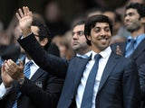 Man City owner Sheikh Mansour waves to fans before a game with Liverpool on August 23, 2010