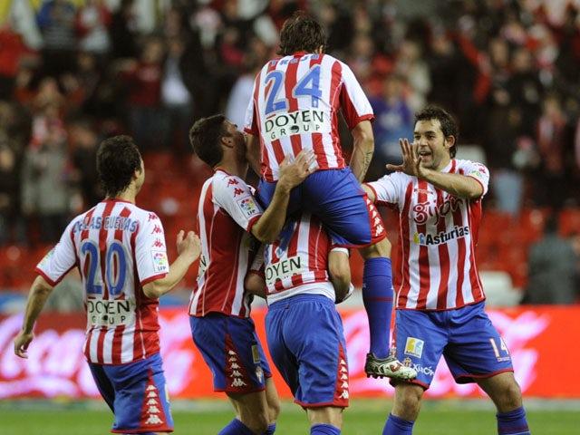 Sporting Gijon's players celebrate their third goal during the Spanish league football match Sporting Gijon vs Levante, at El Molinon stadium, in Gijon, on April 11, 2012