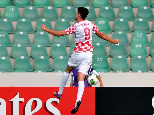 Croatia's forward Stipe Perica celebrates after scoring against New Zealand during a group stage football match between Croatia and New Zealand at the FIFA Under 20 World Cup at Bursa Ataturk Stadium in Bursa on June 29, 2013