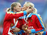 Gold medalist Tatyana Firova and Kseniya Ryzhova of Russia kiss on the podium during the medal ceremony for the Women's 4x400 metres Relay during Day Eight of the 14th IAAF World Athletics Championships Moscow 2013 at Luzhniki Stadium on August 17, 2013