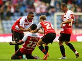 Doncaster's Theo Robinson is congratulated by team mates after scoring the opening goal against Wigan on August 20, 2013