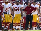 Redskins players stand on the sidelines during a game with Buffalo on August 24, 2013