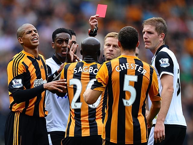 Hull's Yannick Sagbo is shown a straight red card by referee Mike Jones during the match against Norwich on August 24, 2013