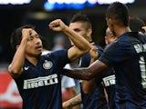 Inter's Yuto Nagatomo celebrates after scoring against Genoa on August 25, 2013