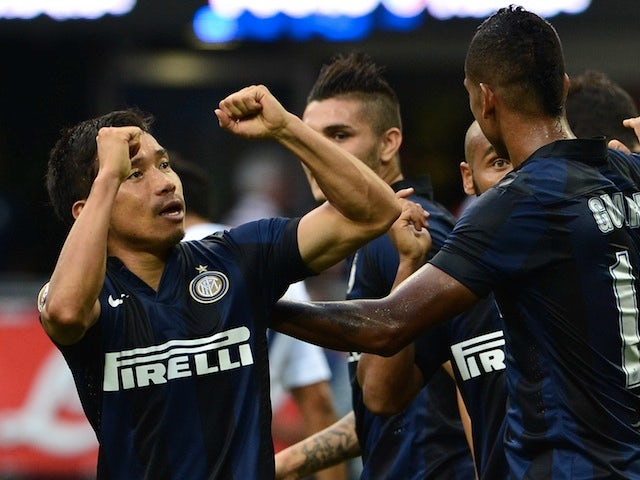 Inter's Yuto Nagatomo celebrates after scoring against Genoa on August 25, 2013