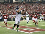 Zach Miller #86 of the Seattle Seahawks catches a fourth quarter touchdown reception against the Atlanta Falcons during the NFC Divisional Playoff Game at Georgia Dome on January 13, 2013