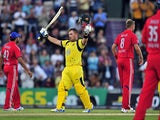 England players look on as Australia's Aaron Finch scores his century during their Twenty20 International cricket match on August 29, 2013