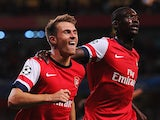 Arsenal's Aaron Ramsey celebrates with team mate Yaya Sanogo after scoring his second goal against Fenerbahce during their Champions League play-off match on August 27, 2013