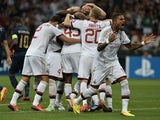 Milan players celebrate a Mario Balotelli goal against PSV Eindhoven on August 28, 2013