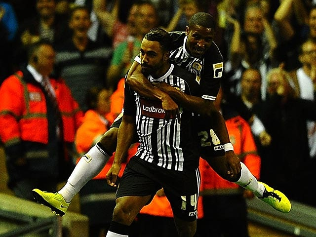 Notts County's Adam Coombes is congratulated by team mate Andre Boucaud after scoring the late equaliser against Liverpool during their League Cup match on August 27, 2013
