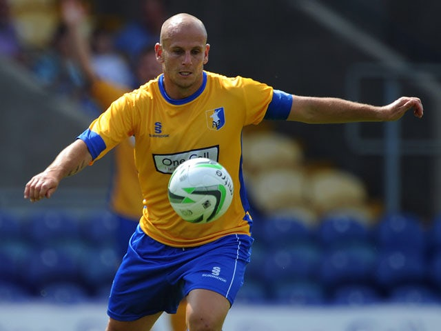 Adam Murray of Mansfield Town in action during the pre-season friendly match between Mansfield Town and Nottingham Forest at One Call Stadium on July 13, 2013