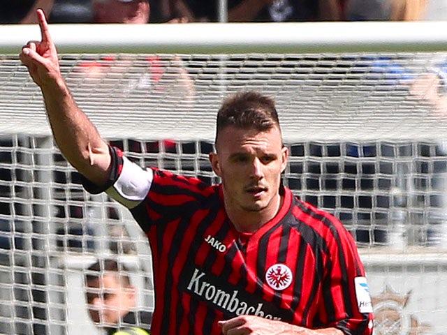 Frankfurt's Alexander Meier celebrates scoring the 1-2 by penalty during the German first division Bundesliga football match Eintracht Frankfurt vs. VfL Wolfsburg in Frankfurt, Germany, on May 18, 2013