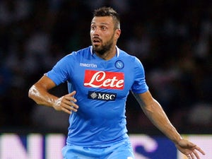 Andrea Dossena of SSC Napoli in action during the pre-season friendly match between SSC Napoli and Galatasaray at Stadio San Paolo on July 29, 2013