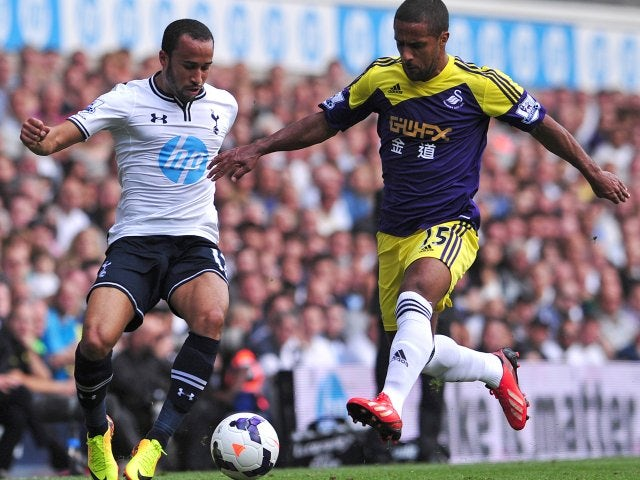 Andros Townsend attempts to beat Wayne Routledge.