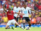 Aaron Ramsey of Arsenal tackles Andros Townsend of Spurs during the Barclays Premier League match between Arsenal and Tottenham Hotspur at Emirates Stadium on September 01, 2013