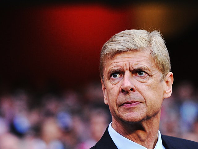 Arsenal manager Arsene Wenger prior to kick-off in the Champions League play-off match against Fenerbahce on August 27, 2013