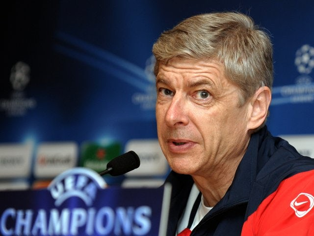 Arsene Wenger talks to the press before an Arsenal Champions League game.