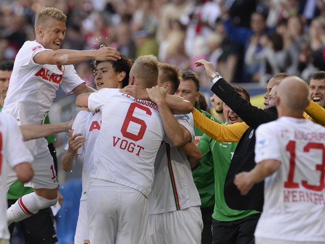 Augsburg's players celebrate after the third goal for Augsburg during the German first division Bundesliga match between FC Augsburg and Greuther Fuerth in Augsburg, southern Germany, on May 18, 2013