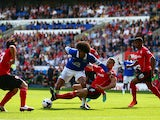 Ben Turner of Cardiff tackles Marouane Fellaini of Everton during the Barclays Premier League match between Cardiff City and Everton at Cardiff City Stadium on August 31, 2013