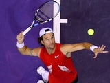 Spanish tennis player Carlos Moya serves the ball at the Madrid Masters on October 14, 2008