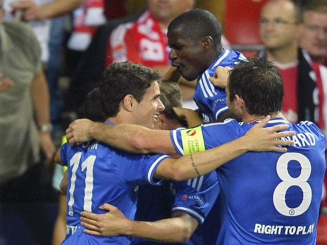Chelsea players surround Fernando Torres after his Super Cup strike against Bayern Munich on August 30, 2013