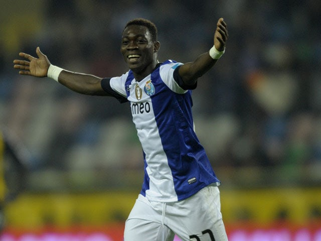 Porto's Ghanaian forward Christian Atsu celebrates after scoring during the Portuguese league football match Beira Mar vs Porto at the Municipal Stadium in Aveiro on February 15, 2013