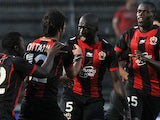 Nice's Dario Cvitanich is congratulated by team mates after scoring the opening goal against Apollon Limassol during their Europa League play-off match on August 29, 2013