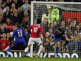 Darren Fletcher loops a header into the net against Chelsea.