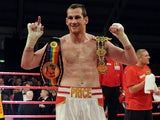 David Price of England poses with the belts following his British & Commonwealth Heavyweight title fight against Matt Skelton of England at Aintree Racecourse on November 30, 2012