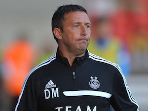 Aberdeen manager Derek McInnes jogs onto the pitch during the Pre Season Friendly match between Aberdeen and FC Twente at Pittodrie Stadium on July 26, 2013