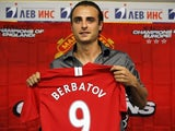 Dimitar Berbatov holds up his shirt at his Manchester United unveiling.