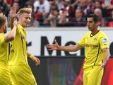 Dortmund's striker Marco Reus celebrates with Dortmund's Armenian midfielder Henrikh Mkhitaryan who scored during the German first division Bundesliga football match Eintracht Frankfurt vs Borussia Dortmund in Frankfurt, central Germany, on September 1, 2