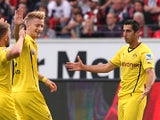 Dortmund's striker Marco Reus celebrates with Dortmund's Armenian midfielder Henrikh Mkhitaryan who scored during the German first division Bundesliga football match Eintracht Frankfurt vs Borussia Dortmund in Frankfurt, central Germany, on September 1, 2