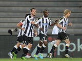 Udinese's Emanuel Badu celebrates with team mates after scoring the opening goal against