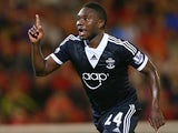 Southampton's Emmanuel Mayuka celebrates after scoring his team's third goal against Barnsley during their League Cup match on August 27, 2013