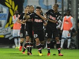 Monaco's Emmanuel Riviere is congratulated by team mates after scoring the winning goal against Marseille on September 1, 2013