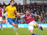 Aston Villa full-back Enda Stevens clears the ball in a Premier League match against Southampton on January 12, 2013