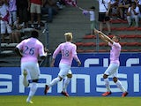 Evian forward Kevin Berigaud celebrates after scoring a goal against Lyon during the Ligue 1 match on August 31, 2013