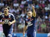 Olympique Lyonnais midfielder Jordan Ferri celebrates after scoring against Evian on August 31, 2013
