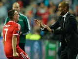 Bayern's Franck Ribery celebrates his goal in the UEFA Super Cup with manager Pep Guardiola on August 30, 2013