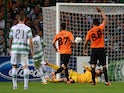 Celtic's Giorgos Samaras tucks the ball past the onrushing Shakhter Karagandy goalkeeper to put his side 2-0 up on August 28, 2013